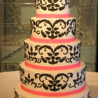Damask Wedding Cake Each piece making up the Damask design is cut from fondant. Fondant ribbon.