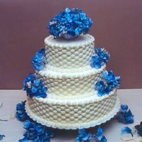 Basketweave Wedding Cake   The flowers were artificial.