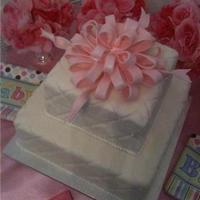 Baby Shower Cake With Quilted Print I made my own baby shower cake with a quilted print and pink fondant bow. The cake was covered in marshmellow fondant (the bow regular...