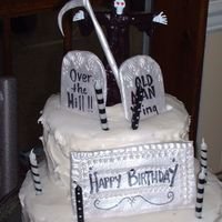 Kristies Dad Bday carrot cake with cream cheese frosting; sicle, skeleton & tombstones are gumpaste; cloak is mmf. i love this grim reaper.