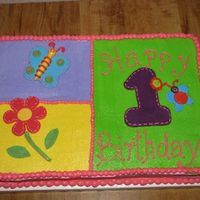Addison's First I've been dying to do one of the Hugs n Stitches cakes. Iced in buttercream with MMF one, butterfly, and flowers.