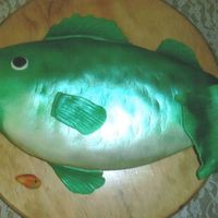 Bass Groom's Cake 9x13 cake carved into fish shape, decorated with fondant and luster dust.