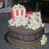 Movie Night This was my first time trying this theme. The cake is yellow buttercream and the icing dark choc buttercream. The popcorn mixture is plain...