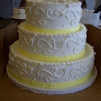 Wedding Cake With Scrolls And Buttercream Ribbon All buttercream with buttercream ribbon around the bottom and scrollwork. The humidity was horrible this day so it was hard keeping it...