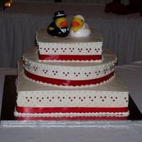 Red And White Wedding Cake 16 inch square, 12 inch round and 8 inch square. All in buttercream with dots and satin ribbon. The bride loves rubber duckies!