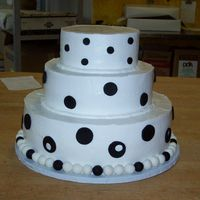 Black And White Wedding Cake   7, 10 and 14 inch frosted in buttercream with black and whitefondant accents.
