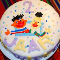 Bert And Ernie i had to make this cake for a boy who loves Bert and Ernie. When he saw the cake he was so happy, he almost cry when they cut the cake.