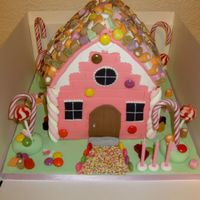 "Candy House 8"" and 6"" square cakes carved into shape of house, covered with sugarpaste and decorated with sweets."