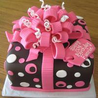 "Fun Birthday 10"" square cake covered with chocolate fondant - bow and curls made from fondant - cake sprayed with Pearl Sheen airbrush to give..."