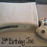 "Xbox 360 xbox 360 and controller.Controller made with RKT covered with fondant and details. 9x13"" sheet cake cut to shape and covered with..."
