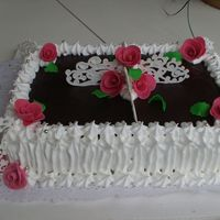 Dark Chokolate And Roses birthday cake made for fried of ud ( mail), cocered with dark chokolate and white cream.