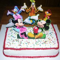 Mickey Mouse Club House Cake   yellow cake, buttercream frosting. embellishments are paper