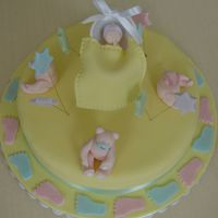 Bears And Baby made a vanilla cake covered in fondant filled with chocolate... bears, baby and stars are fondant and a wilton cradle