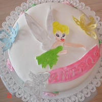 Tinkerbell Birthday Cake Tinkerbell birthday cake filled with rasberry en covered with fondant all figures made out of fondant. TFL