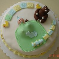 Babyshower cake filled with pudding / all items except the ducks are handmade fondant figures. TFL