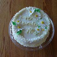Daisy Cake Carrot cake with crusting cream cheese buttercream and fondant accents. I need practice with my writing.