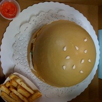 Hamburger Cake  Hamburger is a brownie, the buns are white chocolate cake filled with cheesecake whipped icing. Condiments are made from candy clay and/or...