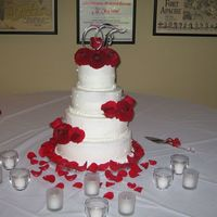 "Roses And Dahlias This is a 12"", 10"", 8"", 6"" round wedding cake, decorated in white buttercream with dots and fresh flowers for..."