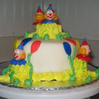 Smash Cake fondant covered smash cake with buttercream clowns