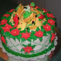 "Feliz Navidad Cake I made this 10"" round cake for a feliz navidad party. Nachos were my inspiration. I then decided to make RI poinsettias to make it a..."
