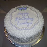 Carolyn_Resize.jpg 10 inch round. All buttercream except for fondant ribbon roses.