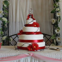 Western Wedding 6, 10,12, 16 inch rounds, white with raspberry filling and buttercream icing. Ribbon around bottom of each tier is satin. The bride...