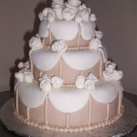 "Mini Wedding Cake   6"", 4"", and 2.5"" white chocolate cake covered and decorated with MMF."