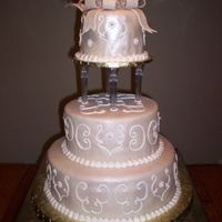 "Ivory Scroll Cake   14"", 10"", and 6"" covered in MMF and RI detail."