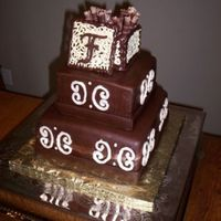 "Chocolate Monogram   10"" and 7"" covered in chocolate MMF, and chocolate box with monogram."