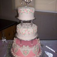 Round Wedding Cake   White chocolate cake with meringue buttercream covered and decorated with cream cheese flavored MMF.