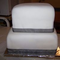 Plain White Fondant Square Cake The lady wanted white with black ribbon and wanted it to look like a box. After I delivered it to her she took it and (I believe put a...