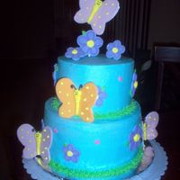 Butterfly Birthday The butterflies and flowers are out of fondant and royal icing, the cake frosted with BC.