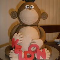 "Monkey.jpg My nephew's 1st birthday cake! The head is the ball pan with the halves separated by a 6"" round. The body is carved our of..."