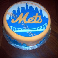 New York Mets My husband is a huge Mets fan, so I made him this cake for his birthday. There are images of the skyline that go around the side as well. I...