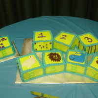 "Baby Blocks 8 4"" baby blocks with animals and numbers. All blocks were cut from 8"" square, iced in buttercream and the animals were piped..."