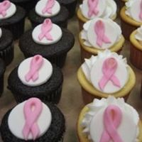 Susan B. Koman's Cancer Awareness Cupcakes  A co-worker helped me make these cupcakes for the bake sale to raise money for the Susan B. Koman's Cancer Awareness Day at work. They...