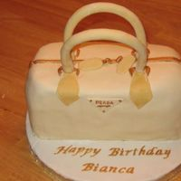 Prada Purse  This was my first attempt at a purse cake. I made it for a co-worker's burthday that is tomorrow, it's a surprise. It is a...