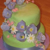 Tulip, Daisy, Apple Blossom Anniversary Cake I made this for my the 3rd anniversary of my DH and mine. Bottom layer is carrot cake, cream cheese frosting and MMF. Top layer is lemon...