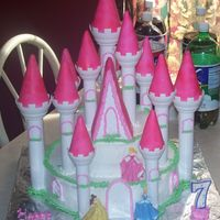 Castle Cake! This is a castle cake I made for my daughters 7th birthday.It is my first time making a castle cake.I used the wilton castle kit.I had my...