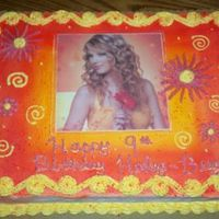 Taylor Swift! I made this for my niece.1/2 sheet fudge marble cake with whipped buttercream icing.