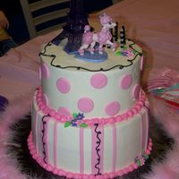 Pink Poodle In Paris Made this for my daughter's 7th birthday. I have to thank ChristyB for her design. Her cake designs are awesome!!