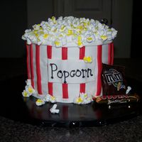 Popcorn Cake Thanks to gladds for her help on the cake. WASC cake with BC and fondant. Took this to my daughter's elementary school family fun...