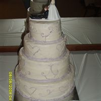 My First Wedding Cake cakes are 6,8,10 and 12 inch the reception hall was so hot the scroll work and frosting was sliding off the cake. Sorry the picture is the...