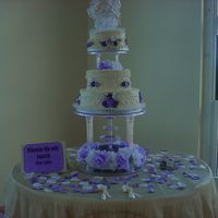 Lavender /purple Wedding I have just returned from setting up this cake for a wedding that's taking place today. A three tiered cake iced with buttercream and...
