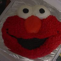 Elmo Cake elmo face cake. I made this with some left over batter from a birthday cake i made previously.