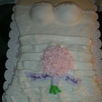 Bridal Surpirse Cake! Bridal shower surprise! Made to look similar to the brides dress. Vanilla cake with whipped frosting and covered in fondant. TFL =)