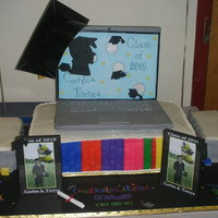 Congrats Graduate! Had fun creating this cake! Computer was made using cardboard and convered and decorated with fondant. Made a numerous of colorful books...