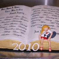 "Audrey's Graduation   book cake with fondant figure of Audrey, her diploma and her pet ""goose goose""."