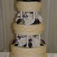 Ivory Wedding Cake  all butter cream icing. base layer is 16, then 14, 12 and 10. base and top layer are WASC and the middle two are hazelnut with chocolate...