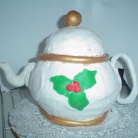 Gail's Christmas Tea Pot. This is the tea pot I made for my Aunt Gail. The cake is vanilia pound cake. Butter cream icing. Fondant accents painted with old gold...